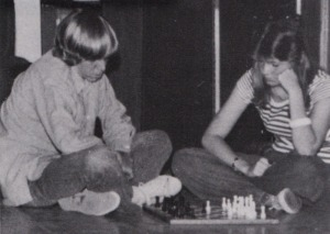 "Rick Bashor and Theresa Smith pass the time playing chess during a scene from ""George Washington Slept Here."""