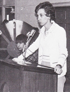 Mrs. Mary Jane White takes her turn at the stand during her last semester on the senior English large group team.