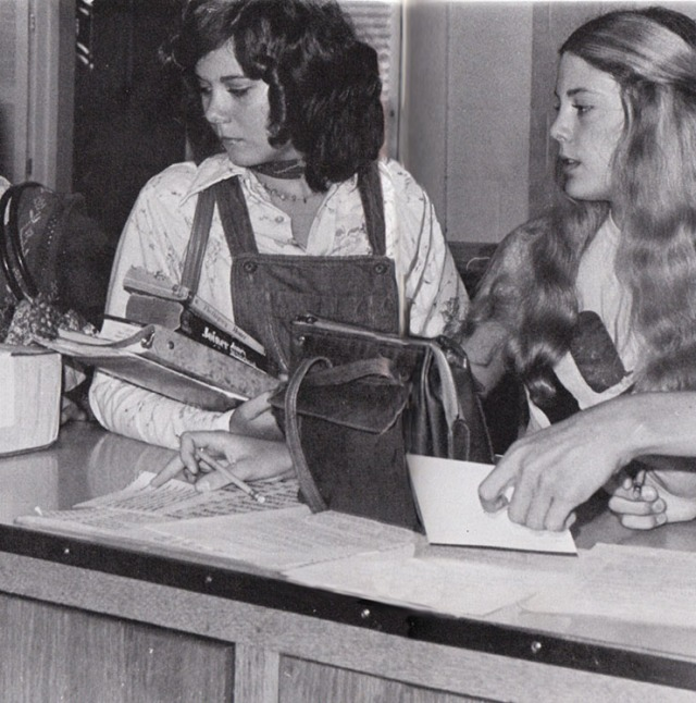 Debbie Norris and Betsy Perkins wait patiently for their turns at the check out desk.